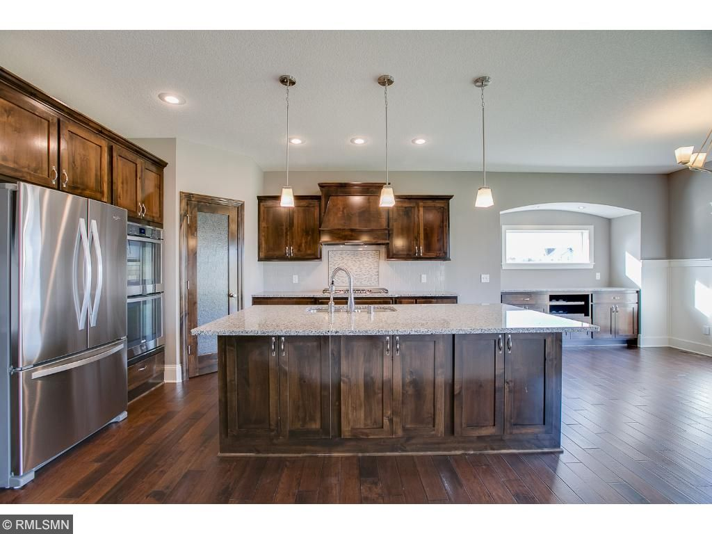 Gourmet kitchen with granite counter tops, tile back splash, Stainless Steel appliances, double wall oven, cook top, walk in pantry and large center island with cabinets on both sides!