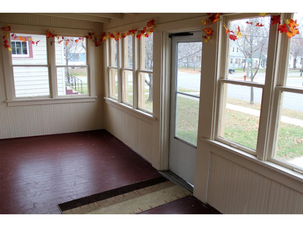Relax in enclosed front porch