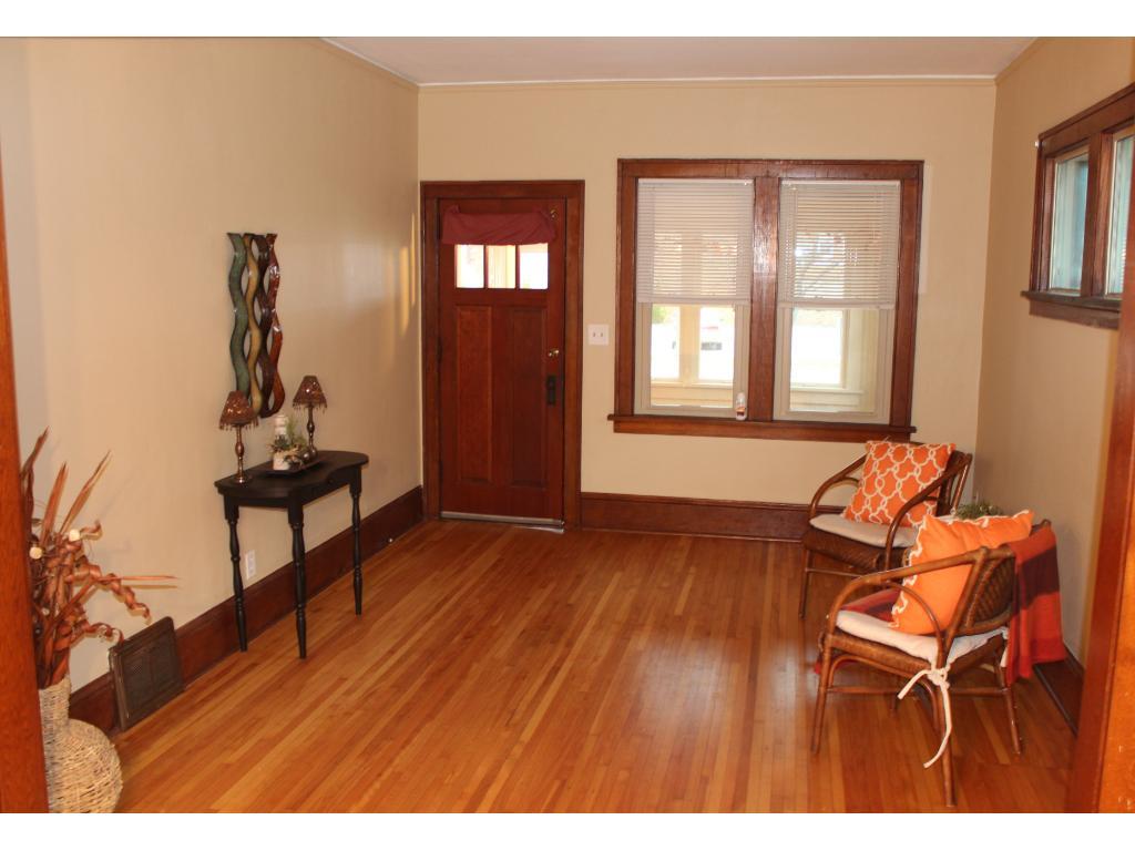 Comfortable living area/hardwood floors
