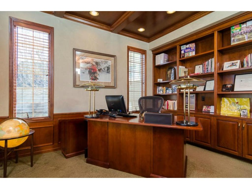 This wonderful Cherrywood Office is located near the front door. Recessed lights show off the wall-to-wall & floor-to-ceiling, built-in bookshelves. Note the coiffure ceiling.