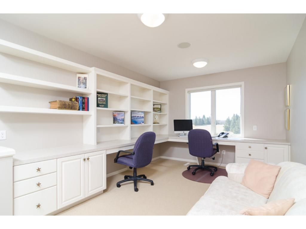 Three more bedrooms are located on the upper level. This handy Loft Area would work great as an extra Office or homework station. Note the multiple workstations.