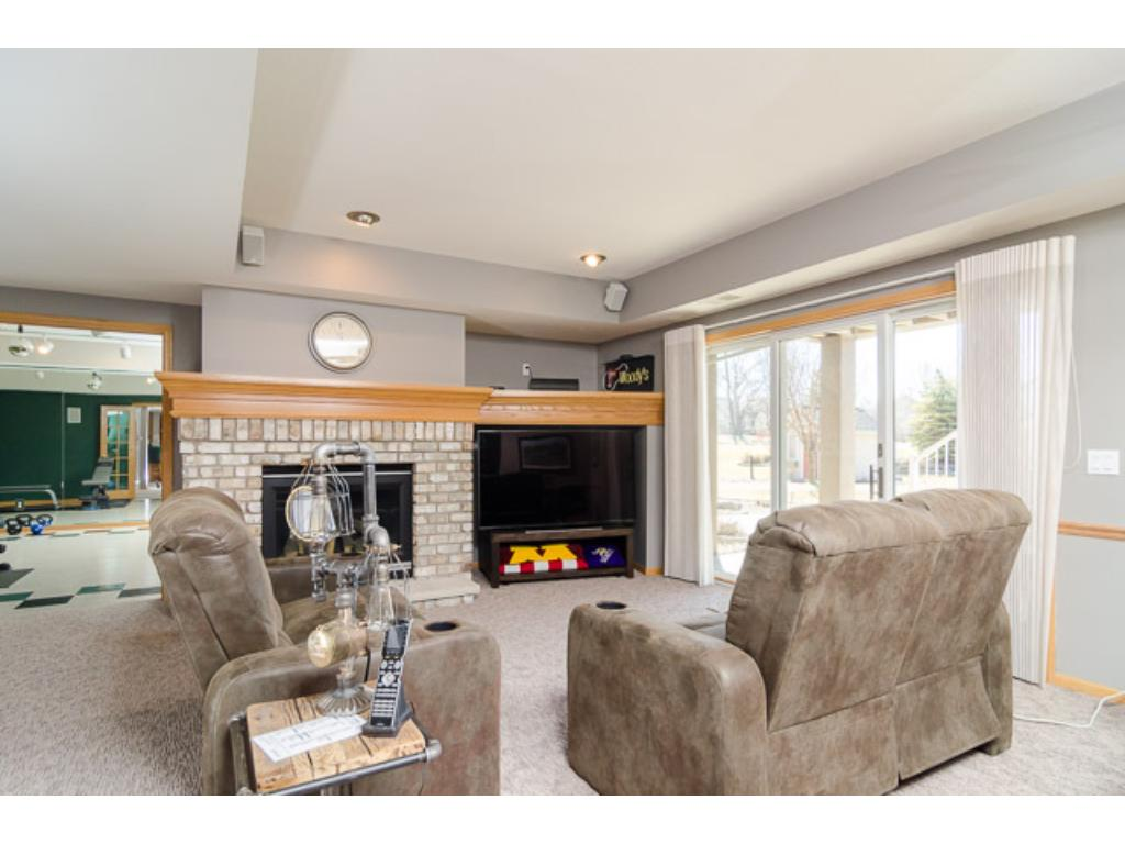 The whole family will enjoy the spacious walkout Family Room. A brick fireplace will keep you warm & toasty this winter.