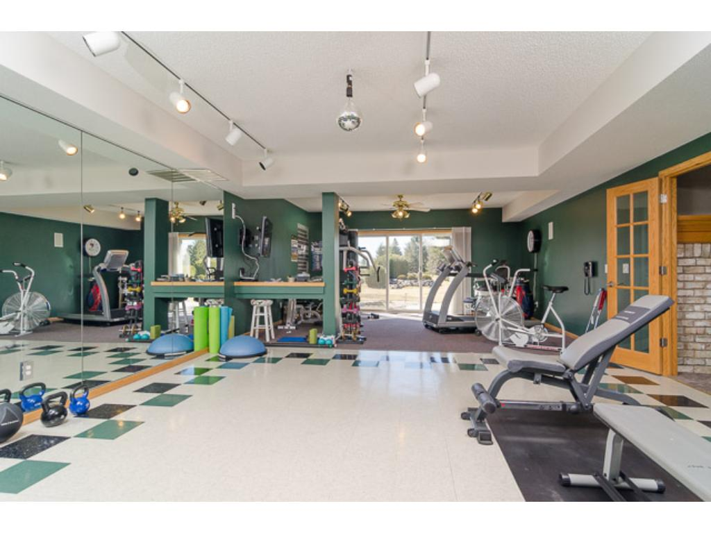 Keep in shape in the Exercise Room offering a wall of mirrors plus a carpeted area & hard floor area. This room could also be a Play Room, Home Theater, or Craft Room.