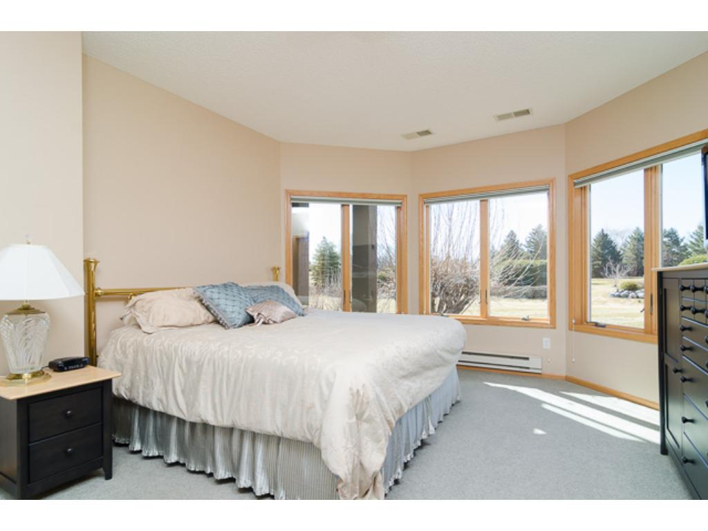 This large bedroom is great for those who like a little privacy. The oversized bay window allows plenty of sunshine in and offers great golf course views.