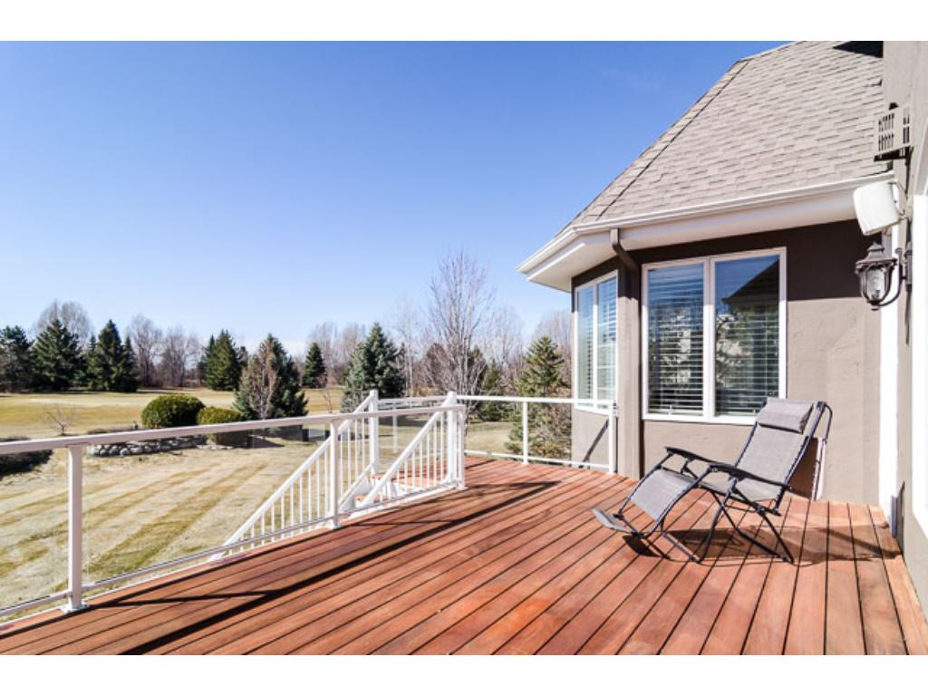 Easy access to the expansive deck with Brazilian Tiger-wood decking & glass railing for outdoor entertaining or family BBQs.