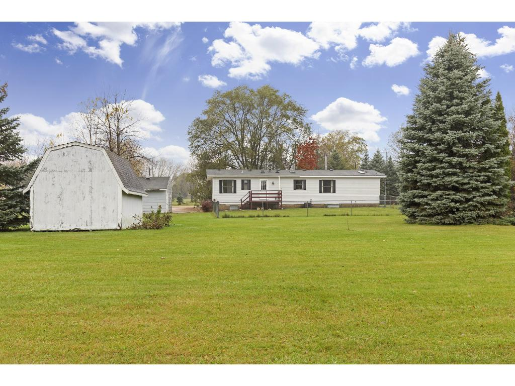 Portion of property is enclosed with a chain link fence!
