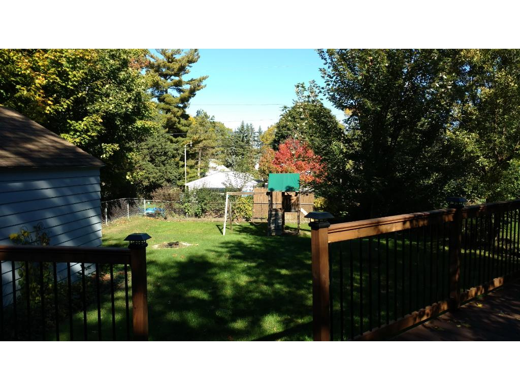 Wonderfully large, fenced in back yard with an extra large deck area for relaxing and entertaining!