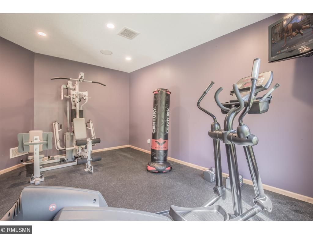 Exercise room with pocket doors allowing more space.
