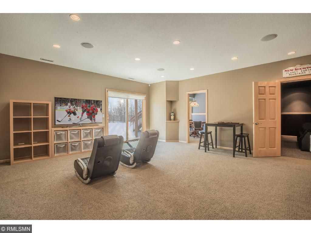 Spacious family room with walk-out to backyard.