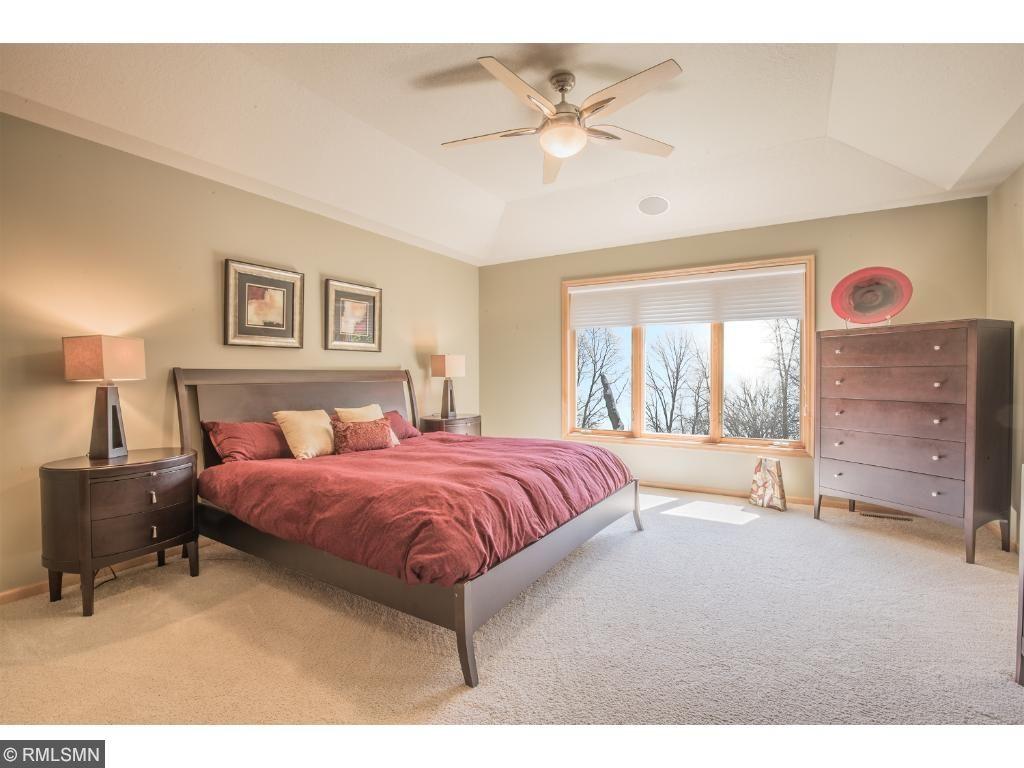Impressive master suite with abundant natural light.