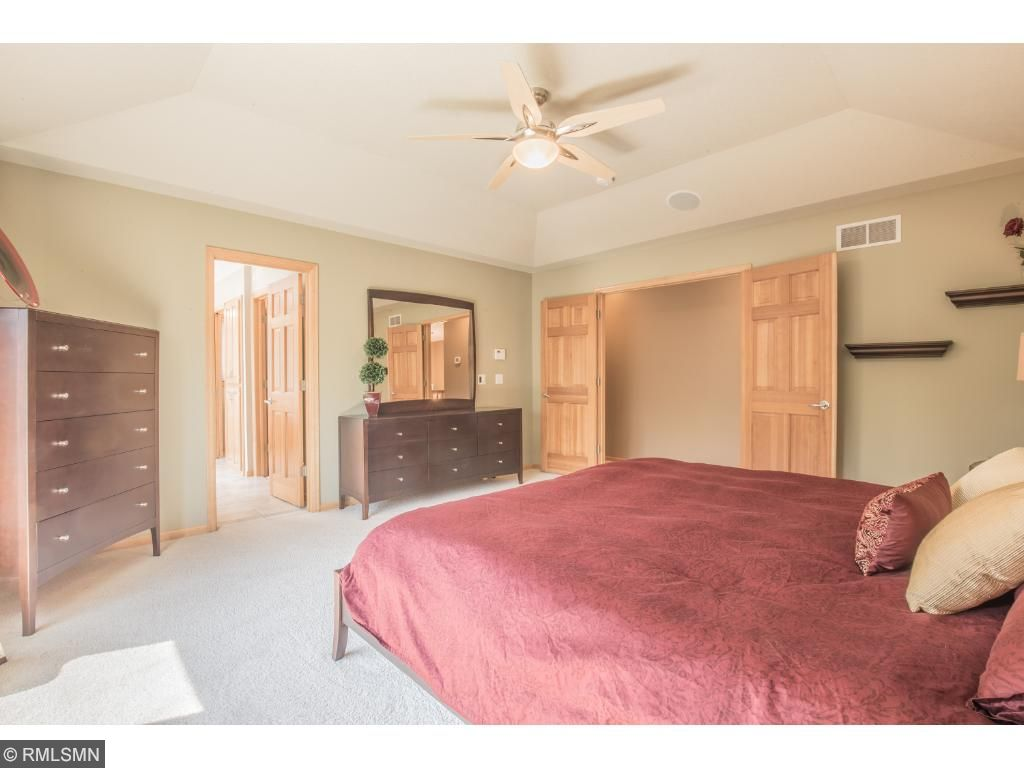 Incredible master suite features tray ceiling with fan and double door entry.