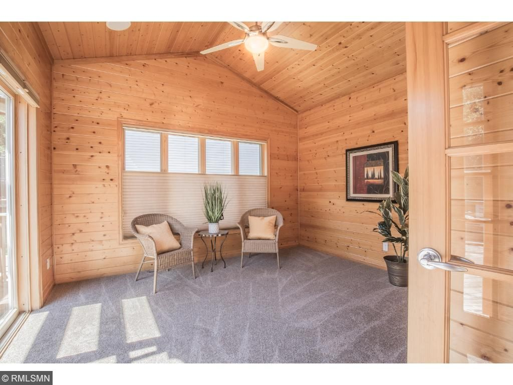 Sunroom offers vaulted ceiling with fan.