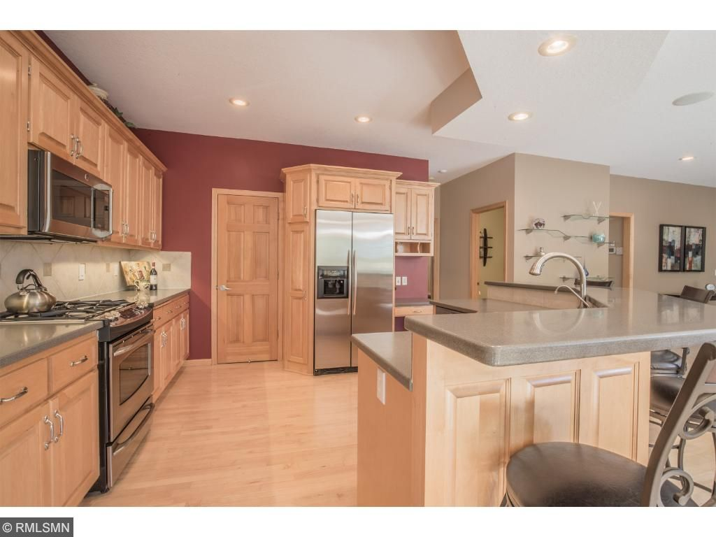 Kitchen with 2 walk-in pantry options, recessed lighting, and workstation.