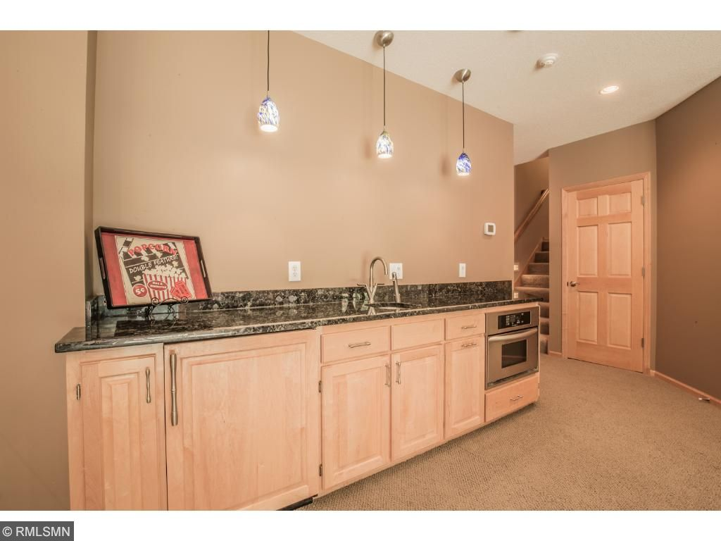 Wet bar includes sink, microwave and refrigerator.