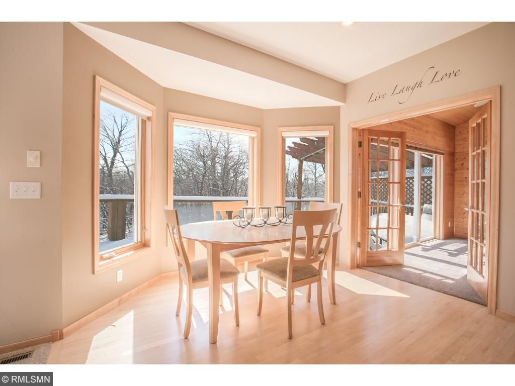 Sun-filled dinette with tranquil views.  Open floor plan for entertaining and family time.