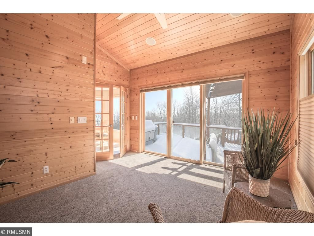 Sunroom offers French doors and easy deck access.