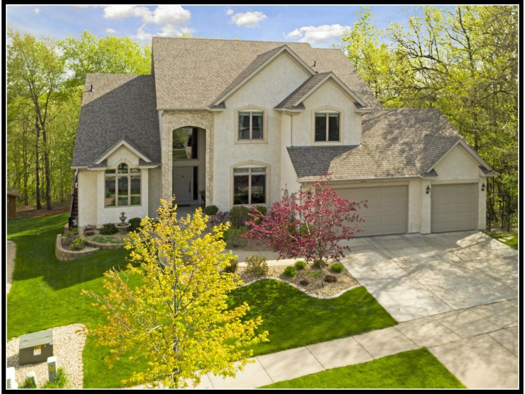 Welcome home to 16381 69th Place North - a two-story home on a private wooded lot at the end of a cul-de-sac!