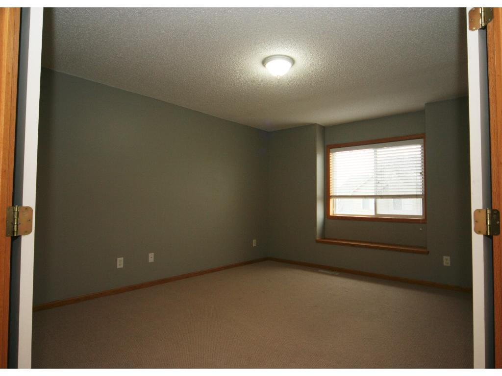 Spacious master complete with your own private bath, walk-in closet, and window bench seat. Great retreat space!