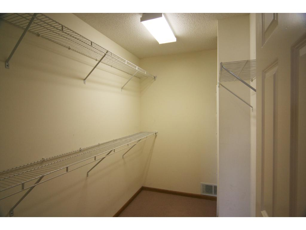 The Master Walk-In Closet with shelving ready for your wardrobe!