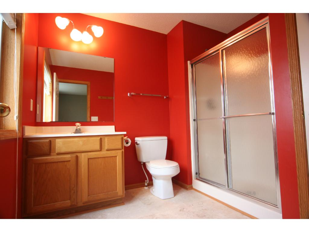 Bright and Cheerful Master's bath that includes a storage closet and Brand New Travertine tile Flooring!