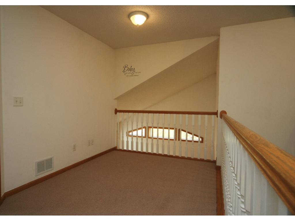 Open overlook Loft area right out side the masters suite. Great space for an office, play area, or maybe nursery!