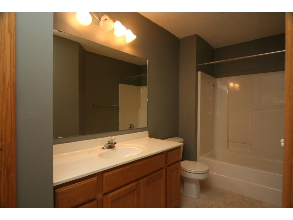 Upper level full bath with Brand New Travertine Tile flooring and Fresh Paint & a storage closet!