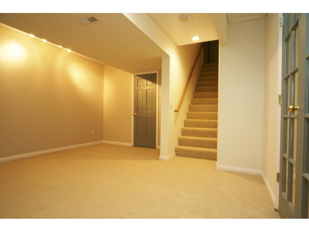 Brand new carpet and lighting! Bright and roomy! Spacious maintenance/storage room!