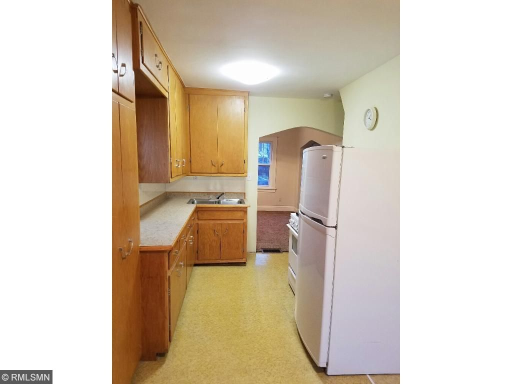 Kitchen features original cabinets in great shape
