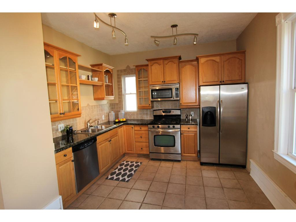 Granite counter tops, stainless steel appliances, lots of windows for natural light