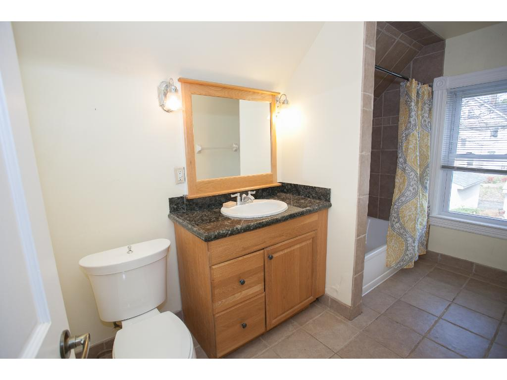 Upper level full bath has a completely resurfaced tub, spacious for bathing children and natural light