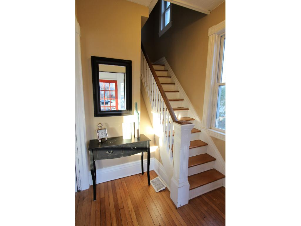 You are welcomed into your home by gleaming hardwood floors