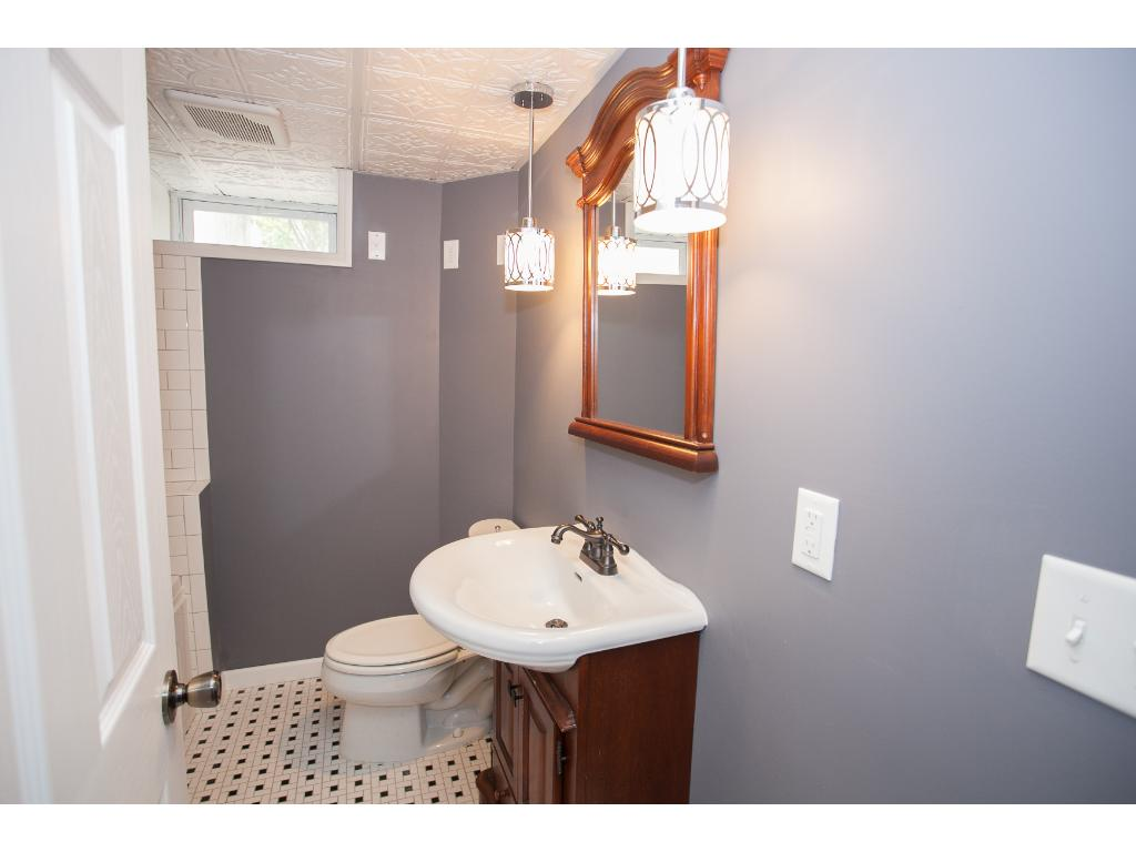 Lower level bath has been completely refinished with a huge Jacuzzi tub, wonderful tile and great lighting