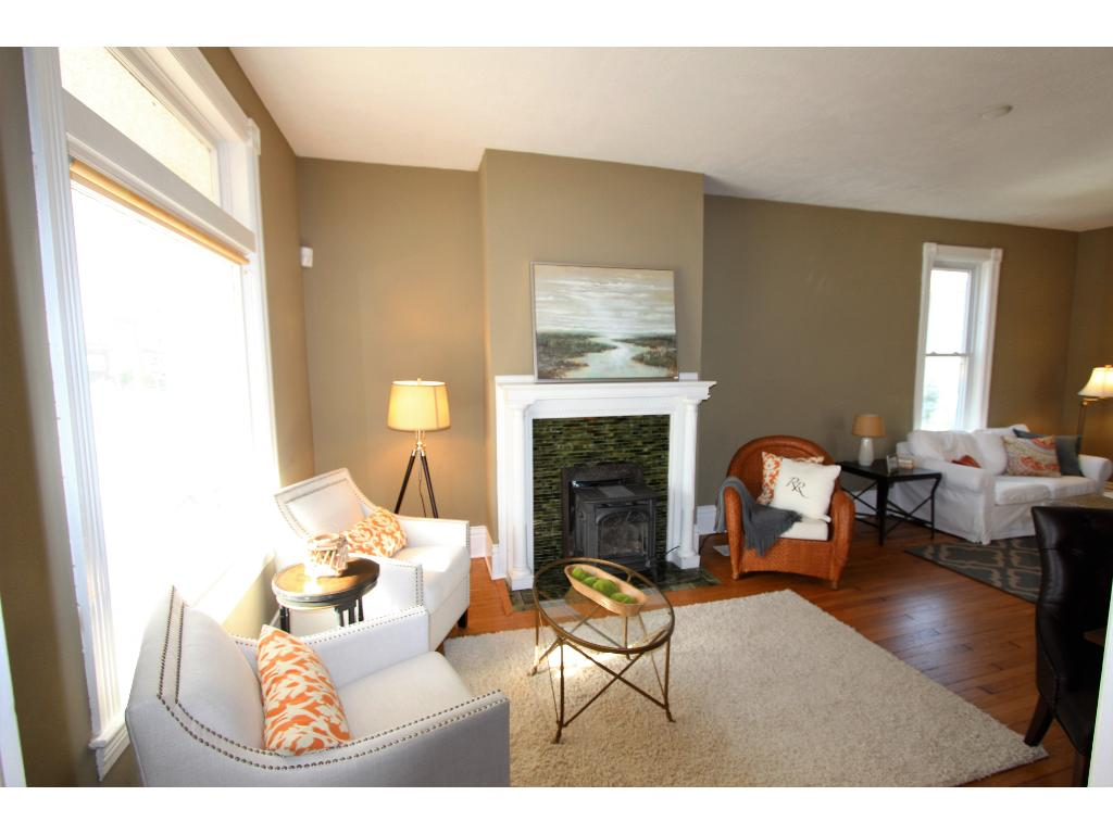 Living room has wonderful features: Pocket door to close off the upper bedrooms, gas fireplace to snuggle up to, huge picture window to let in the natural light.....