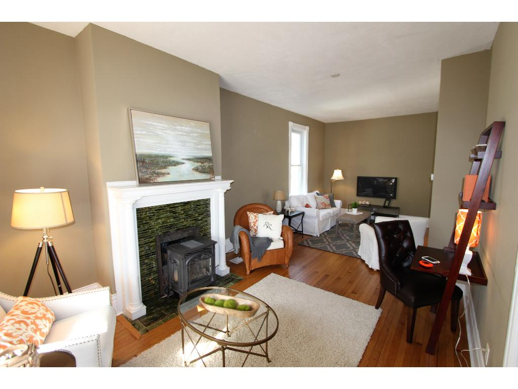 Additional features of the living room: Extremely tall ceilings, beautiful mantle surrounding the gas fireplace, lots of space