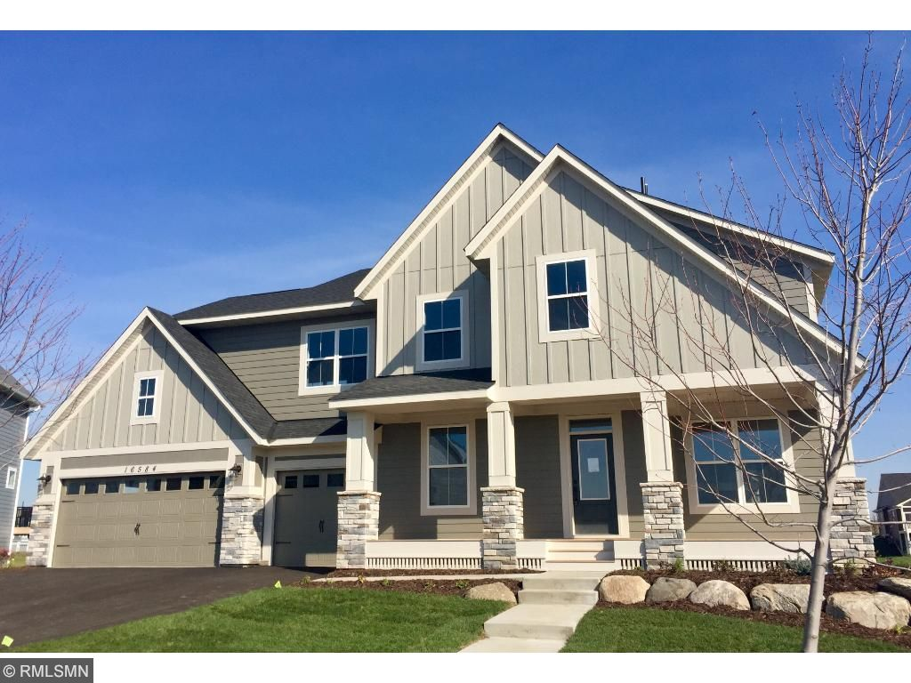 Modern Farmhouse Elevation With Full Front Porch And Stone Accents Four Sided Architectural Detailing