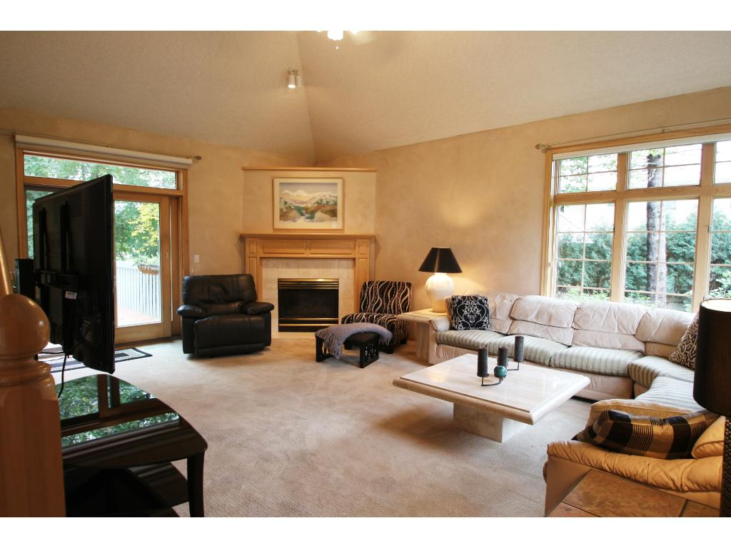 Generous sized living room with gas burning fireplace. Super natural light flows in!