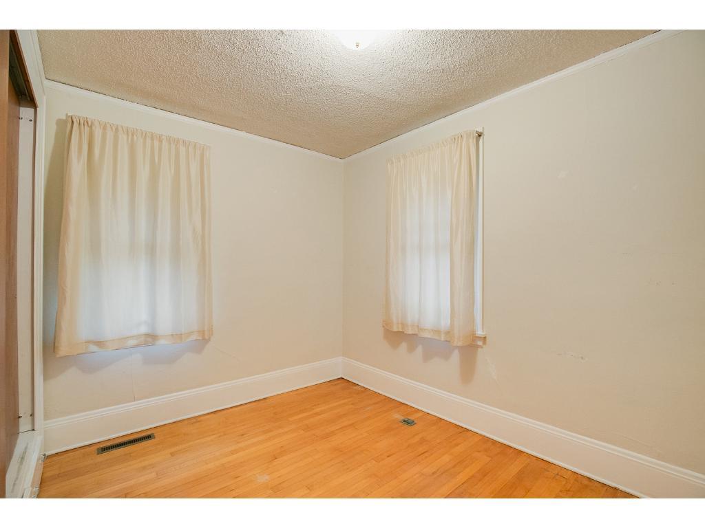 Another main floor bedroom with beautiful hardwood floors!