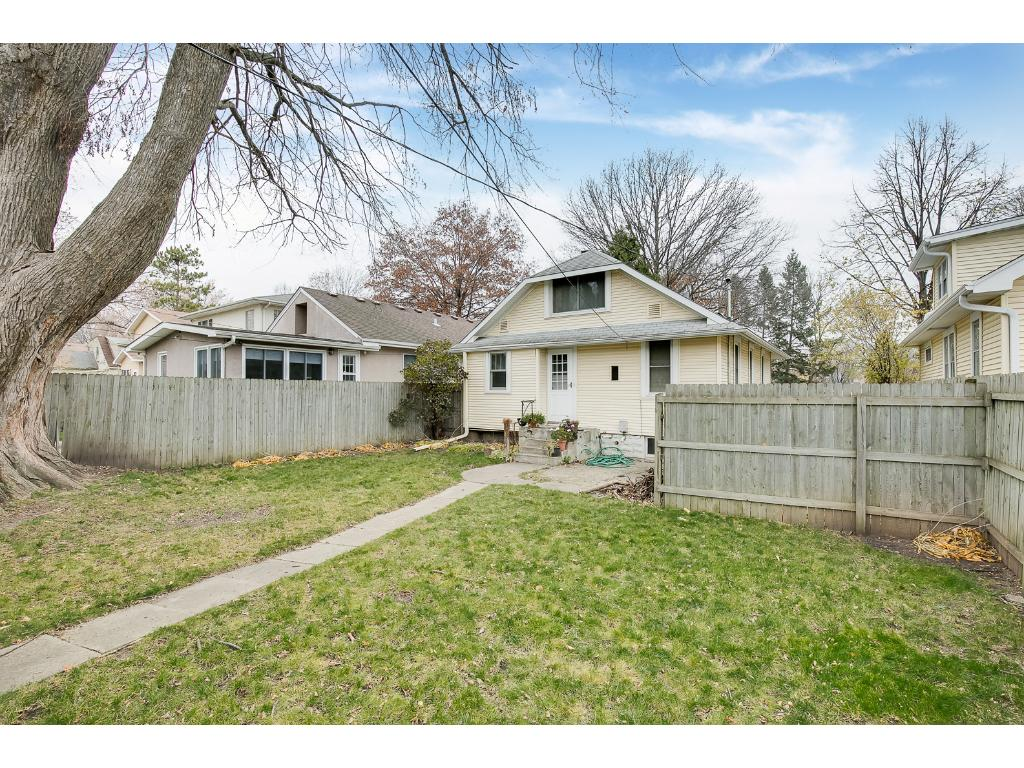 Large backyard with privacy fencing! Perfect for kids or pets!