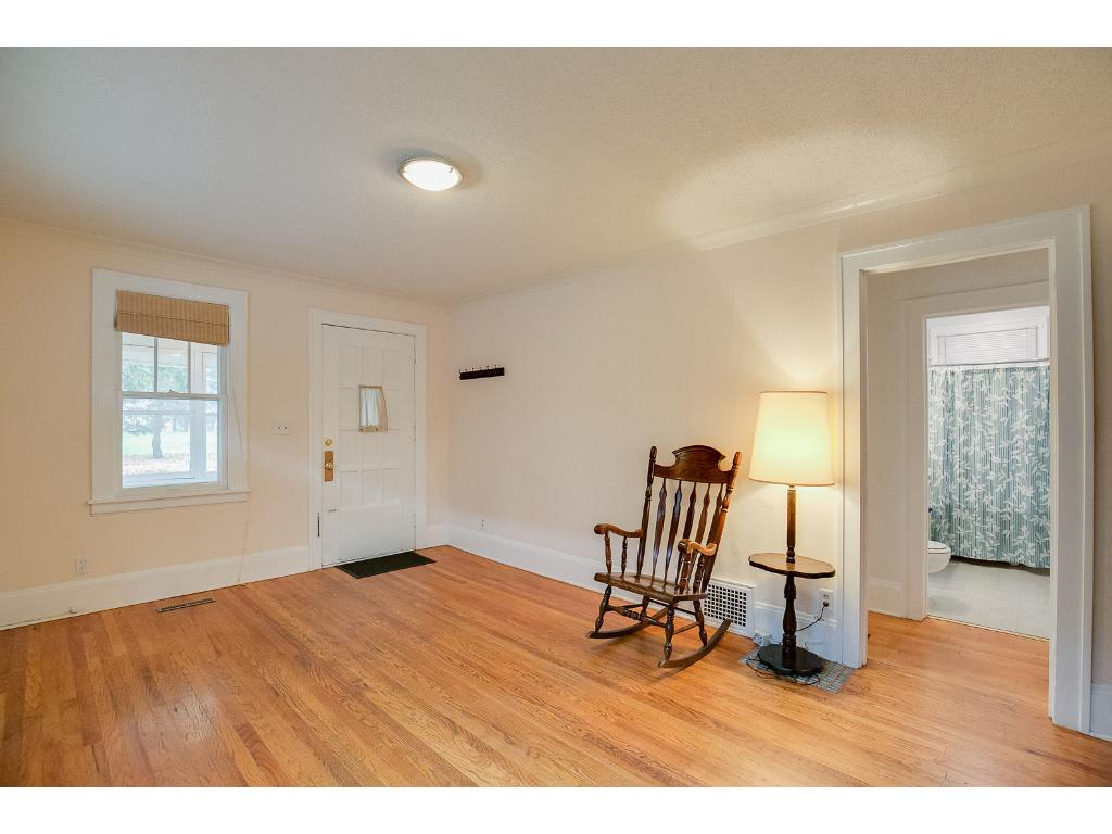 Spacious main floor living room features gleaming hardwood floors!