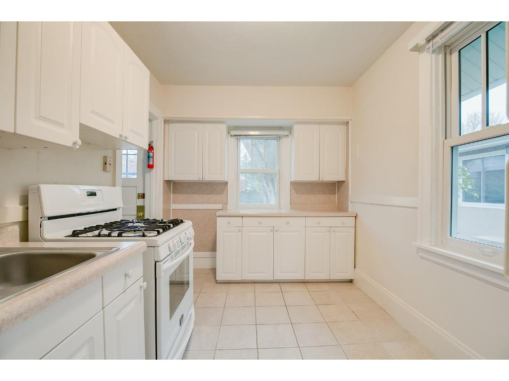 Spacious main floor eat-in kitchen features ample cabinet storage space!
