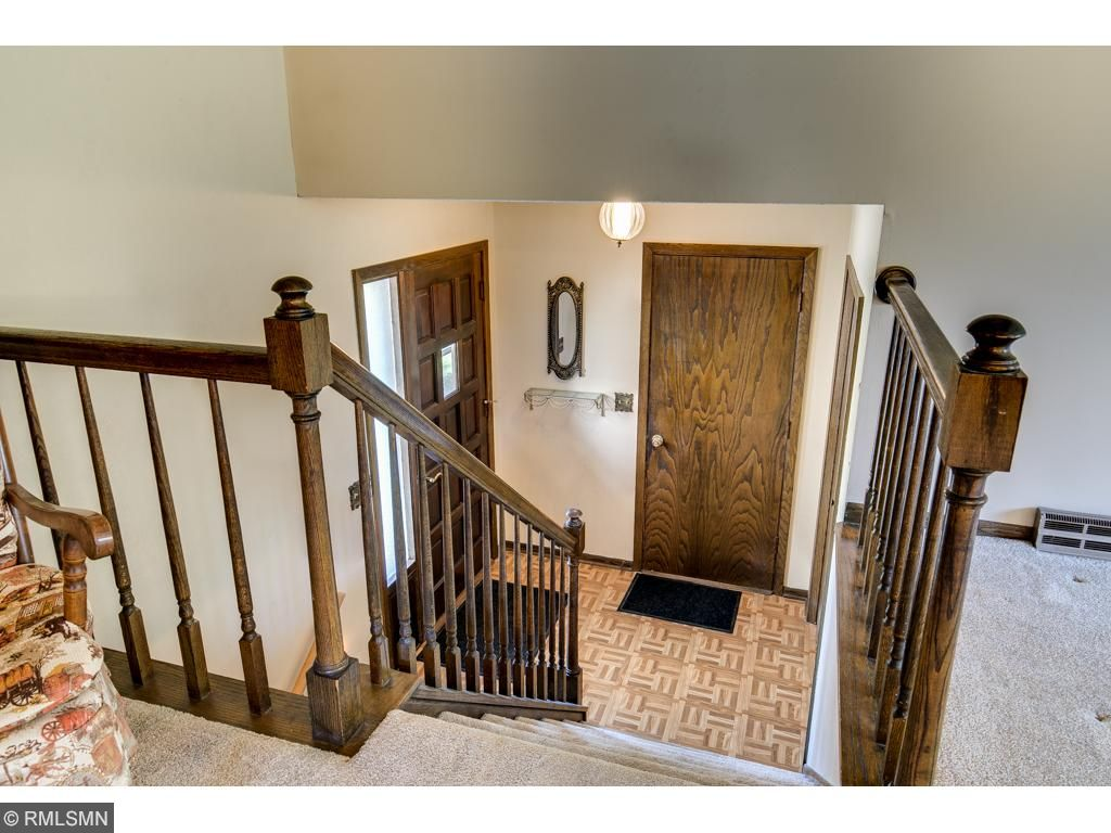 The main entryway walks up to the spacious living area and walks down to the walkout lower level.