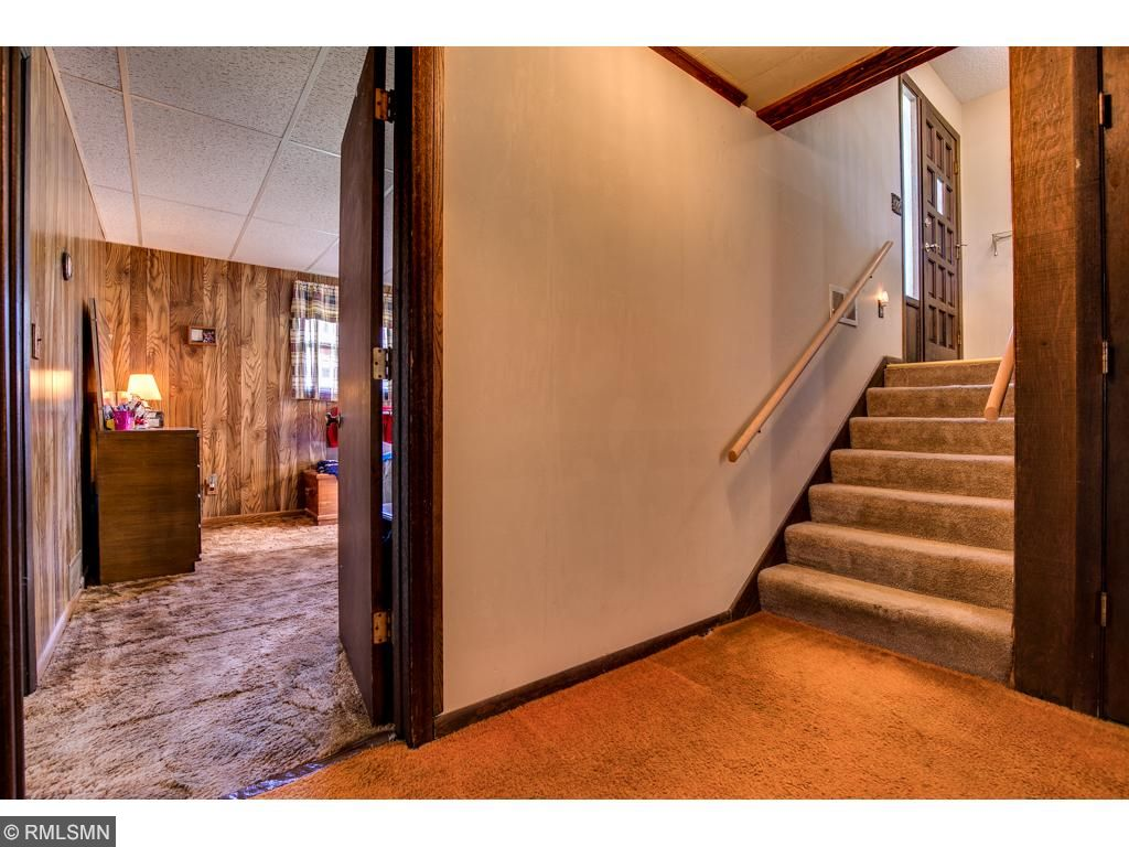 The main entryway walks down to the walkout lower level.