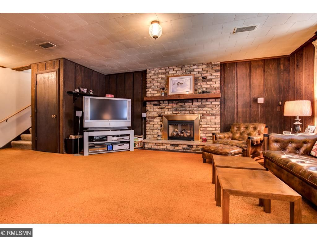 The lower level has a family room with a gas fireplace, a master bedroom with a large master bathroom and a 3 season porch that walks out to the fenced in pool area.