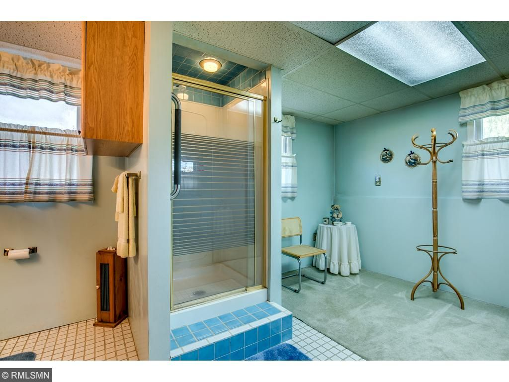 The lower level master bedroom is serviced by a large 3/4 master bathroom with an additional closet area.