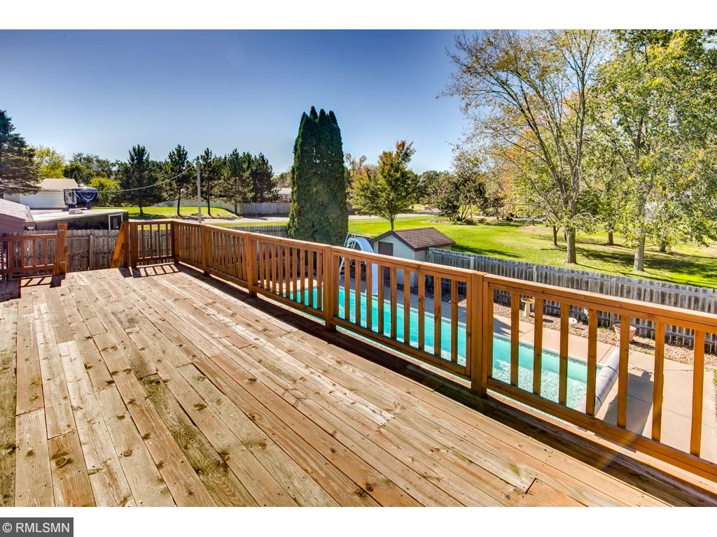 The main level dining room walks out to the large deck and walks down to the fully fenced pool and backyard.