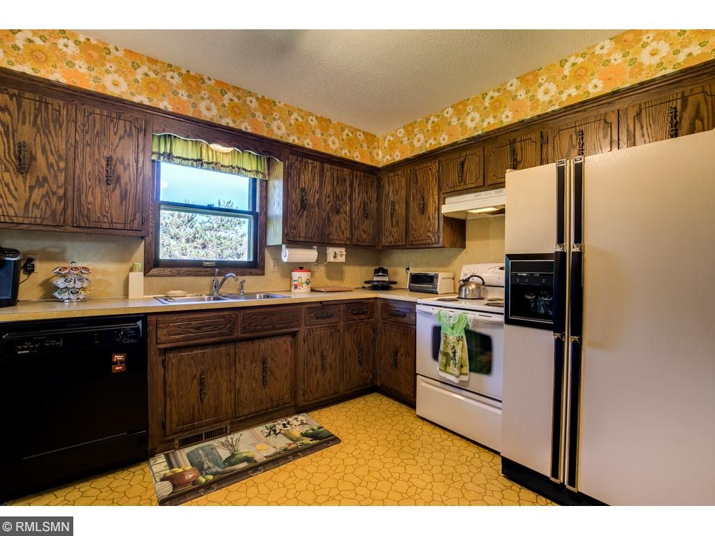 The kitchen has a window letting in natural light and walks into the living room and dining room.