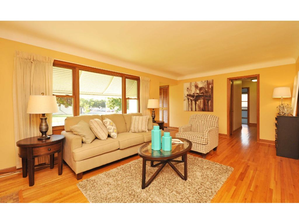 Nice living room with hardwood floors, fireplace, and picture window