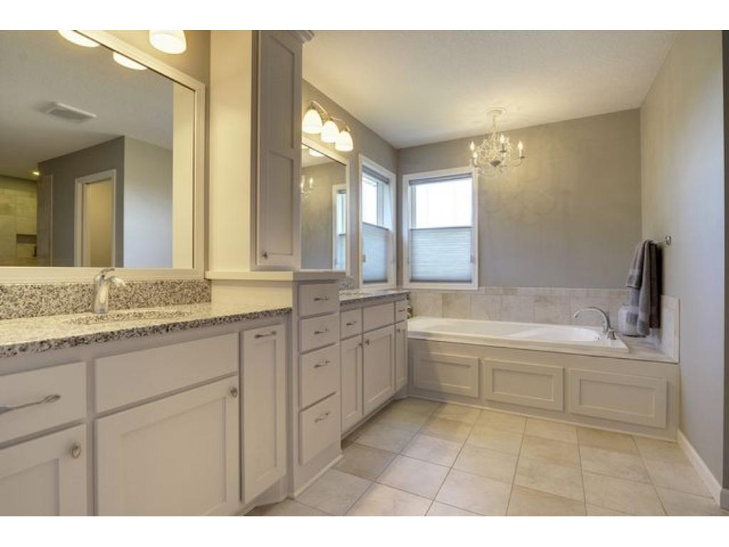Escape in this private master bath, with a large soaker tub, walk-in shower, dual vanity, and tremendous walk-in closet.