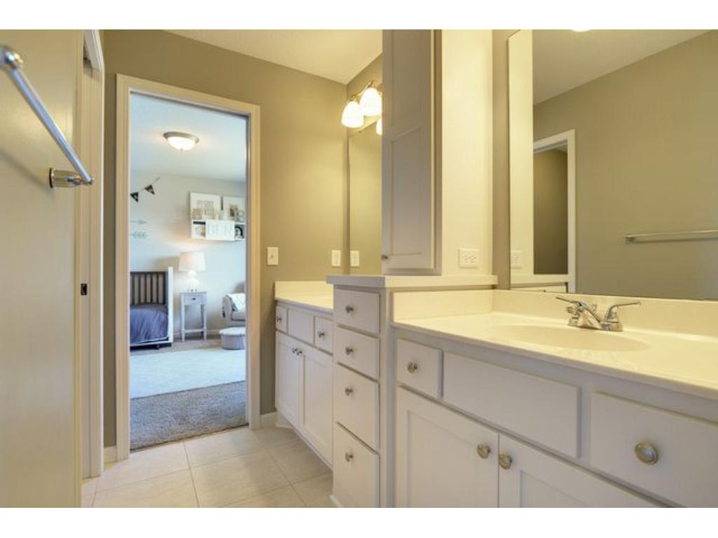 This full jack and jill bath has dual vanities, which makes it perfect for sharing.