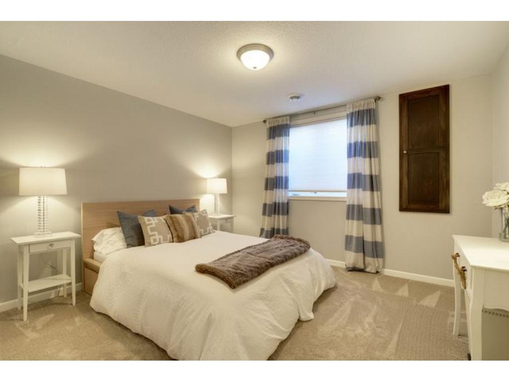 The lower level bedroom is private, and makes for an ideal space for your guests to stay.